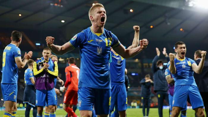 Oleksandr Zinchenko of Ukraine celebrates victory over Sweden at Euro 2020
