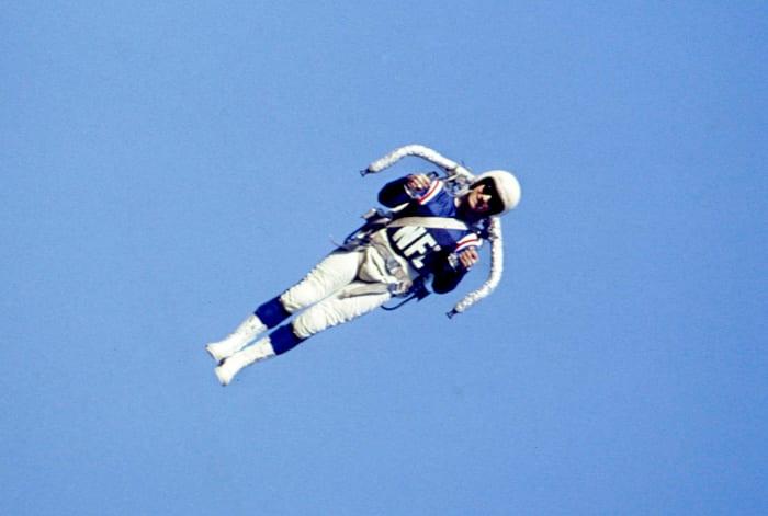 Willie Suitor pilots a rocket belt at Super Bowl I.