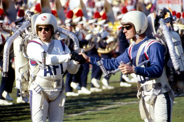 Bob Courter and Willy Suitor, representing the AFL and NFL, came together to soar into the sky at Super Bowl I.