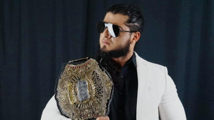 Ring of Honor Rush champion poses with his title