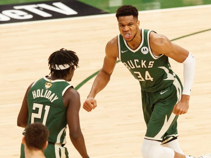 Milwaukee Bucks forward Giannis Antetokounmpo (34) reacts after a basket during the third quarter against the Phoenix Suns during Game 3 of the 2021 NBA Finals at the Fiserv Forum.