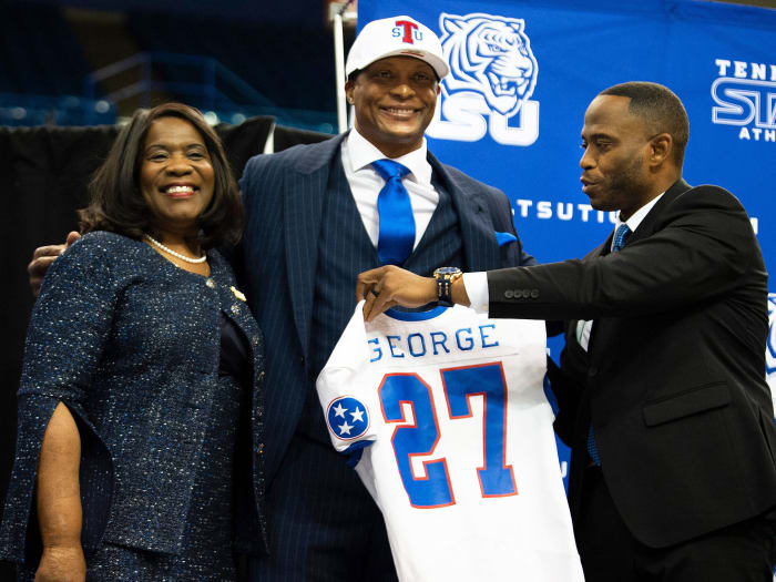 Tennessee State's Eddie George receives a jersey