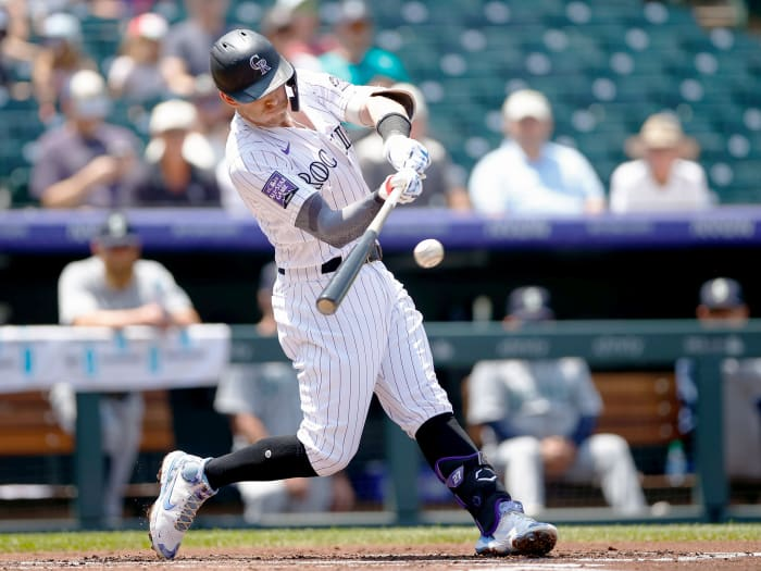 July 21, 2021;  Denver, Colorado, United States;  Trevor Story (27), shortstop for the Colorado Rockies, singles in the first inning against the Seattle Mariners at Coors Field.
