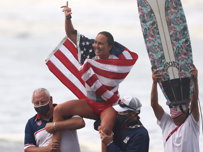 Carissa Moore of Team United States celebrates winning the Gold Medal after her final match against Bianca Buitendag of Team South Africa on day four of the Tokyo 2020 Olympic Games at Tsurigasaki Surfing Beach on July 27, 2021 in Ichinomiya, Chiba, Japan.