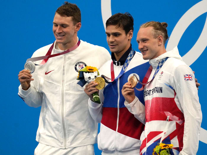 Ryan Murphy (USA), from left, Evgeny Rylov (ROC) and Luke Greenbank (GBR) pose with their medals after taking the top spots in the men's 200 backstroke final during the Tokyo 2020 Olympic Summer Games