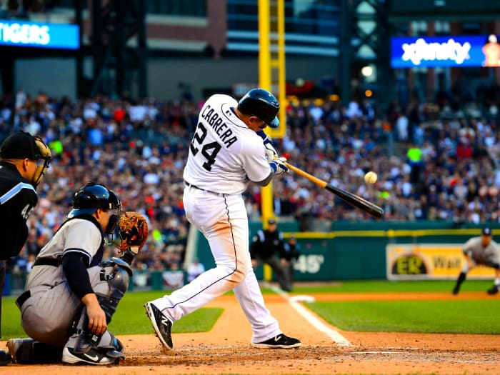 Miguel Cabrera of the Detroit Tigers swings and hits a ball.