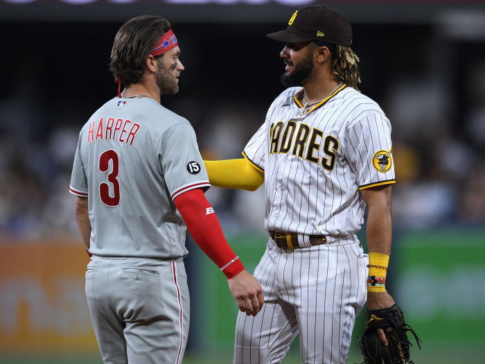 Philadelphia Phillies right fielder Bryce Harper (3) and San Diego Padres center fielder Fernando Tatis Jr. (right) talk during the middle of the sixth inning at Petco Park.