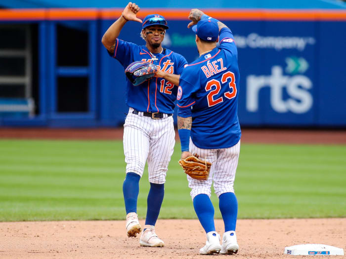 Aug 29, 2021; New York City, New York, USA; New York Mets shortstop Francisco Lindor (12) and second baseman Javier Baez (23) celebrate after defeating the Washington Nationals 9-4 at Citi Field.
