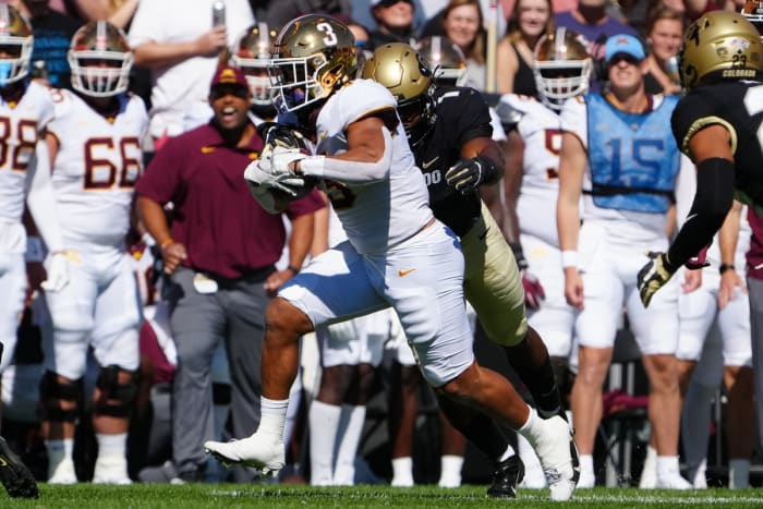 September 18, 2021;  Boulder, Colorado, United States;  Minnesota Golden Gophers running back Treyson Potts (3) carries the ball past Colorado Buffaloes linebacker Guy Thomas (1) in the first quarter at Folsom Field.  Mandatory Credit: Ron Chenoy-USA TODAY Sports