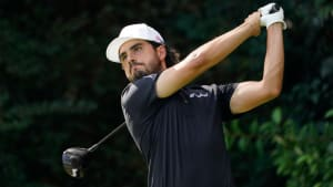 Abraham Ancer plays his shot from the 14th tee during the final round of The Masters golf tournament at Augusta National GC.