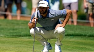 Mar 12, 2021; Ponte Vedra Beach, Florida, USA; Dustin Johnson lines up his putt on the seventh green during the second round of The Players Championship golf tournament at TPC Sawgrass - Stadium Course.