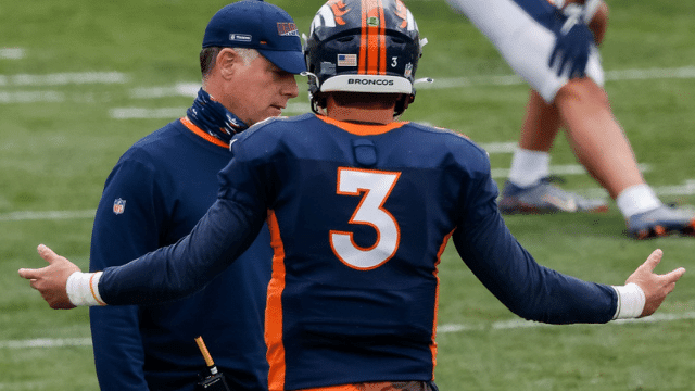Denver Broncos quarterback Drew Lock (3) with offensive coordinator Pat Shurmur during practice at UCHealth Training Center.