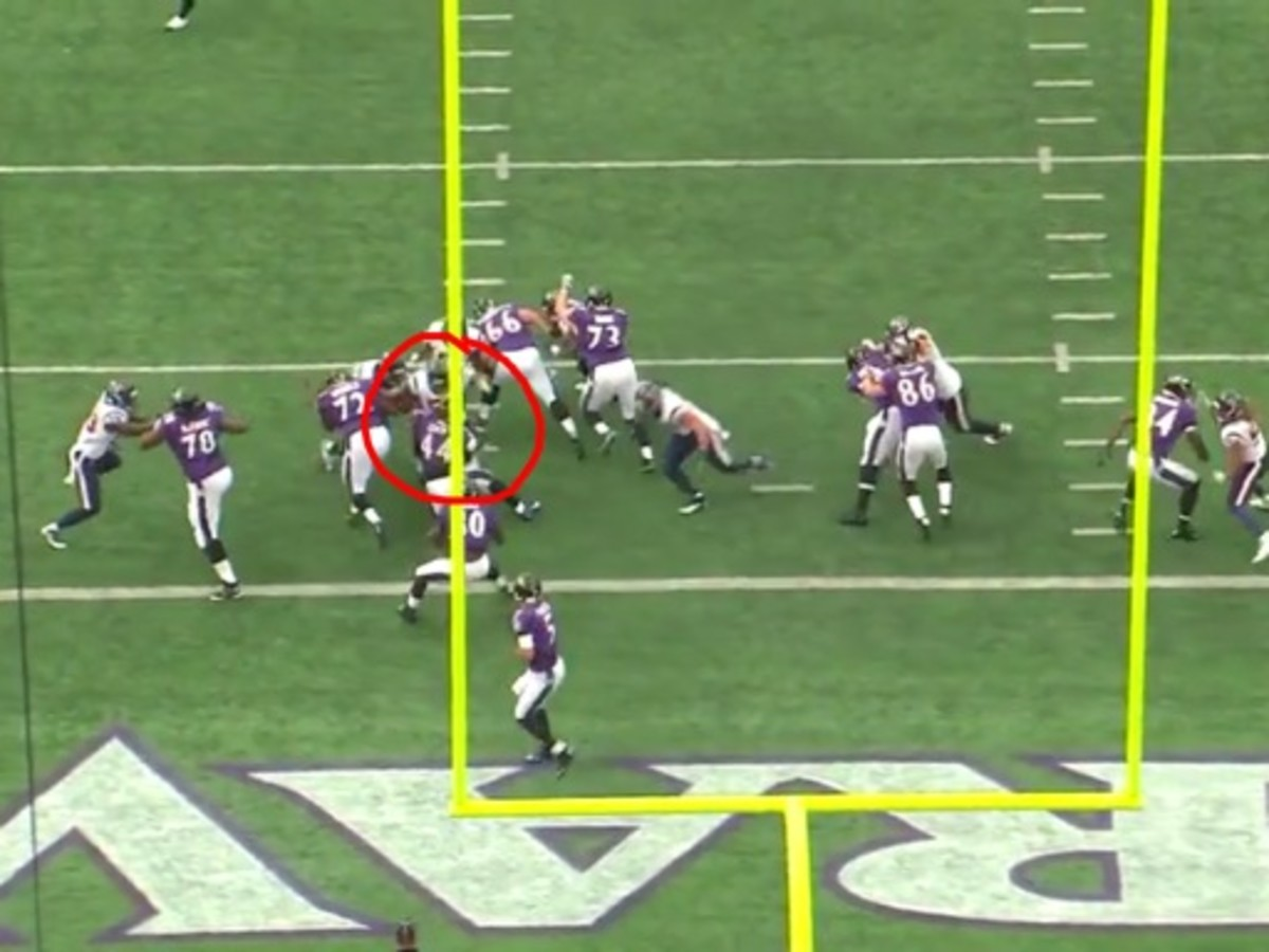 The goal post is in the way, but Mays folds up Leach in the backfield and creates lanes for Cushing and Sharpton to make the play.