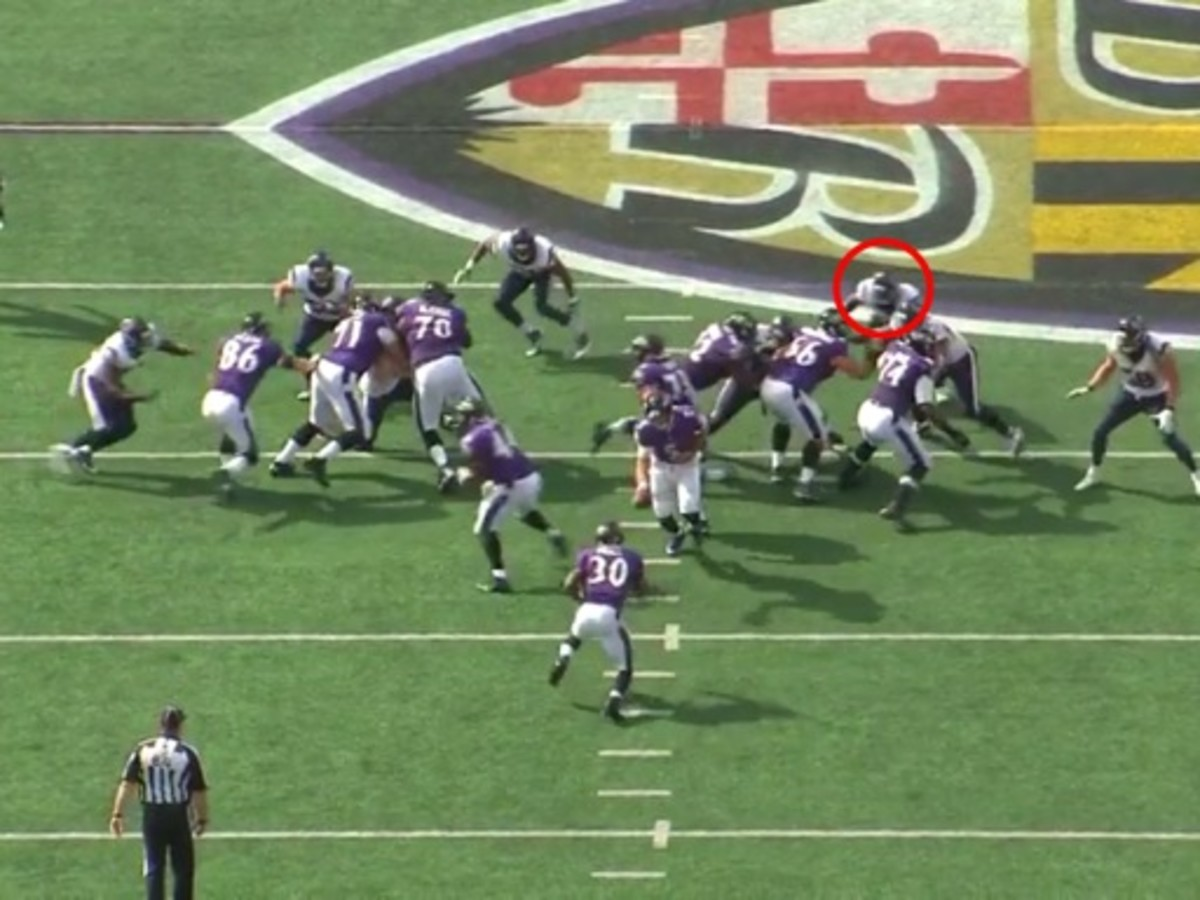 Mays is watching the play develop and he sees that the play is away. As a linebacker if they have a crease to make a play they are taught to take it. With the center blocking back the hole is opening up perfect for Mays to attack downhill.