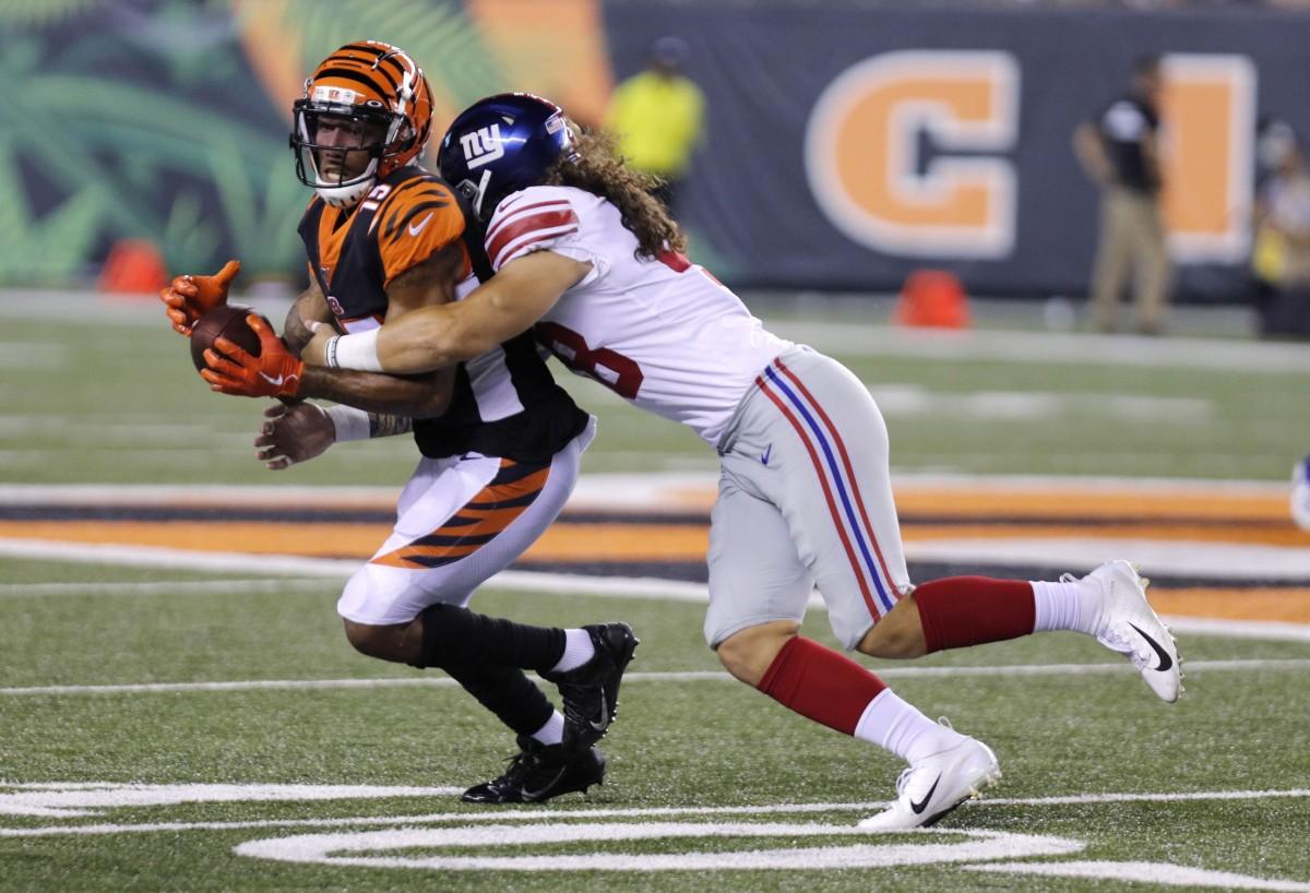 Aug 22, 2019; Cincinnati, OH, USA; Cincinnati Bengals wide receiver Hunter Sharp (15) is tackled by New York Giants linebacker Josiah Tauaefa (48) during the second half at Paul Brown Stadium.
