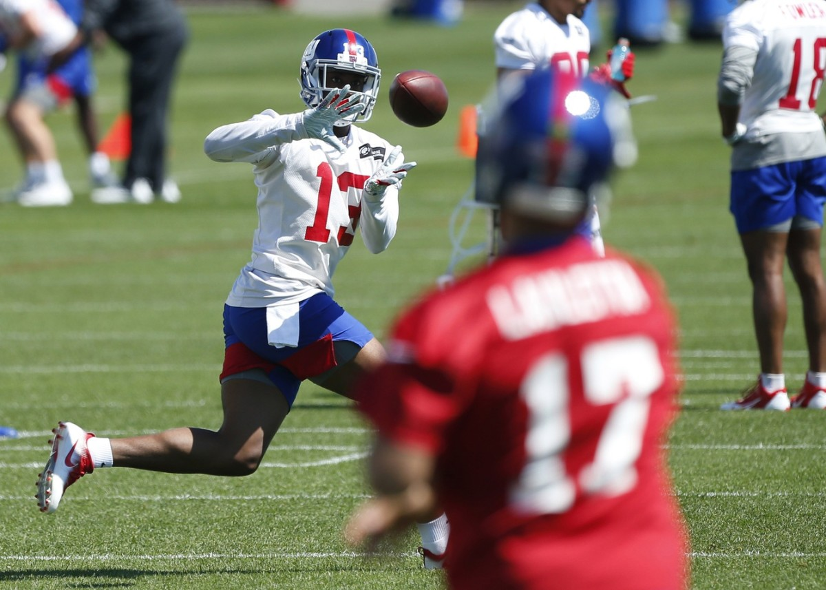 Jun 4, 2019; East Rutherford, NJ, USA; New York Giants wide receiver Reggie White Jr. (13) makes a catch during mini camp at Quest Diagnostic Training Center.