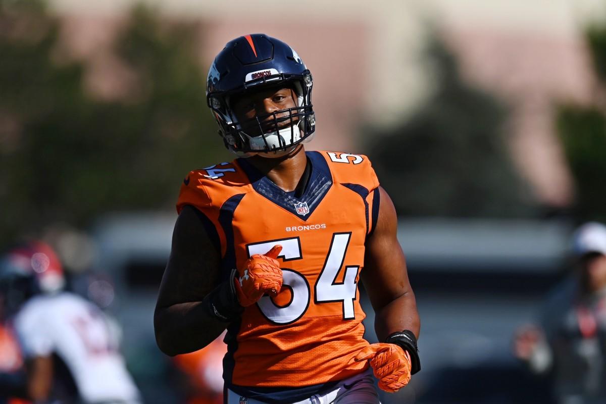 Denver Broncos linebacker Josh Watson (54) during drills at the UCHealth Training Center.