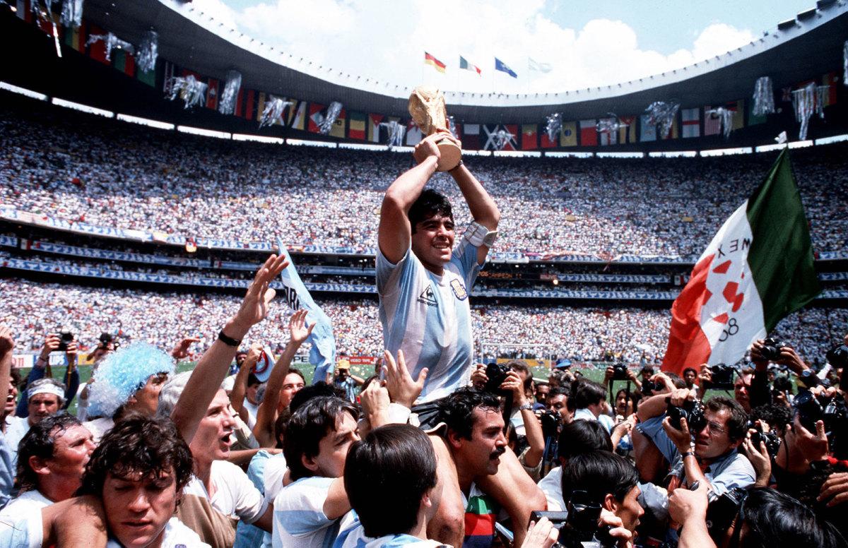 Diego Maradona lifts World Cup trophy