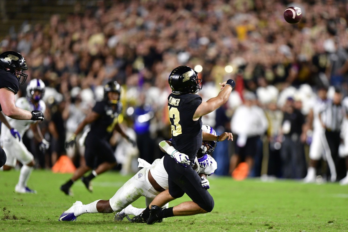 West Lafayette, IN, USA; TCU Horned Frogs linebacker Dee Winters (13) pressures Purdue Boilermakers quarterback Jack Plummer (13) during the second quarter of the game at Ross-Ade Stadium. Mandatory Credit: Marc Lebryk-USA TODAY Sports
