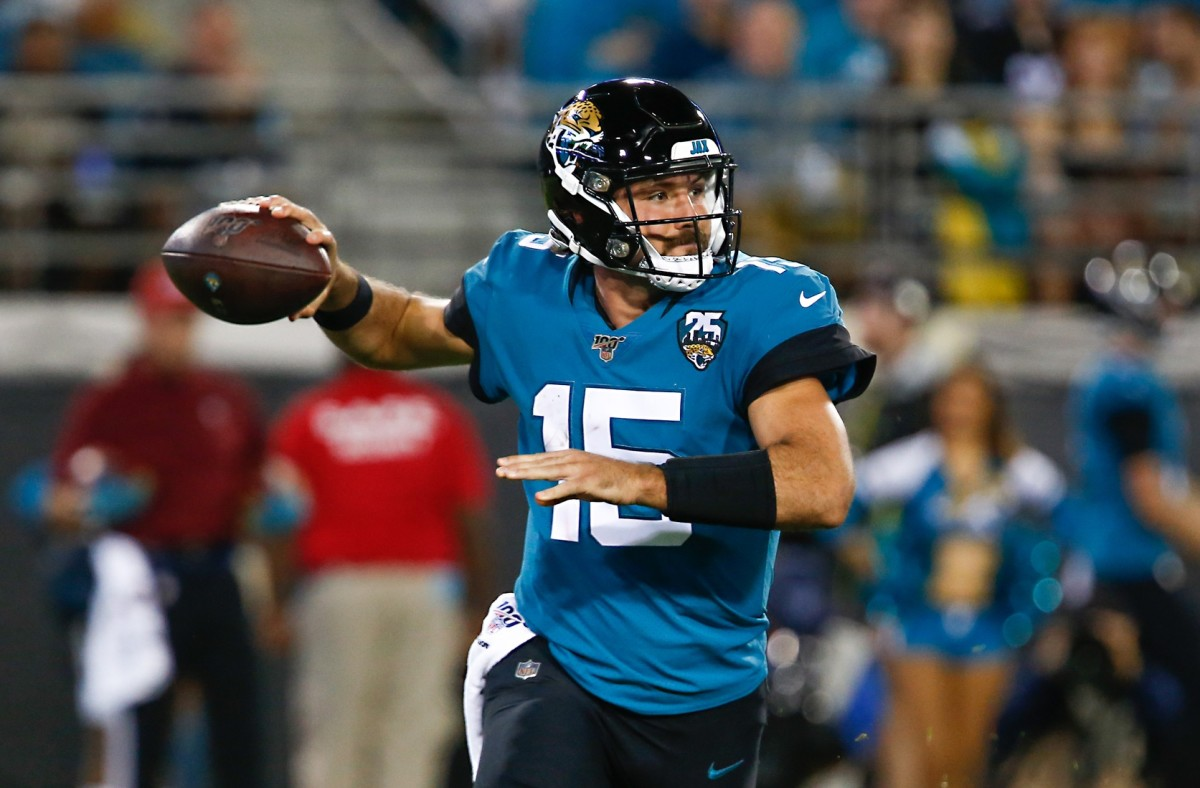 Jacksonville Jaguars quarterback Gardner Minshew (15) drops to throw a pass during the second half against the Tennessee Titans at TIAA Bank Field.