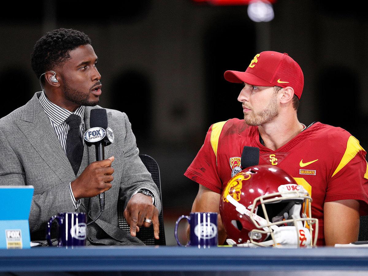 FOX Sports analyst and former USC star Reggie Bush interviews Trojans QB Matt Fink after the team's win over Utah.