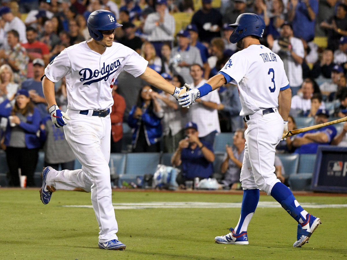 Corey Seager is greeted by Chris Tayler after Seager's three-run home run against the Colorado Rockies at Dodgers Stadium on Sept. 20, 2019, in Los Angeles, California. (John McCoy/Getty Images)