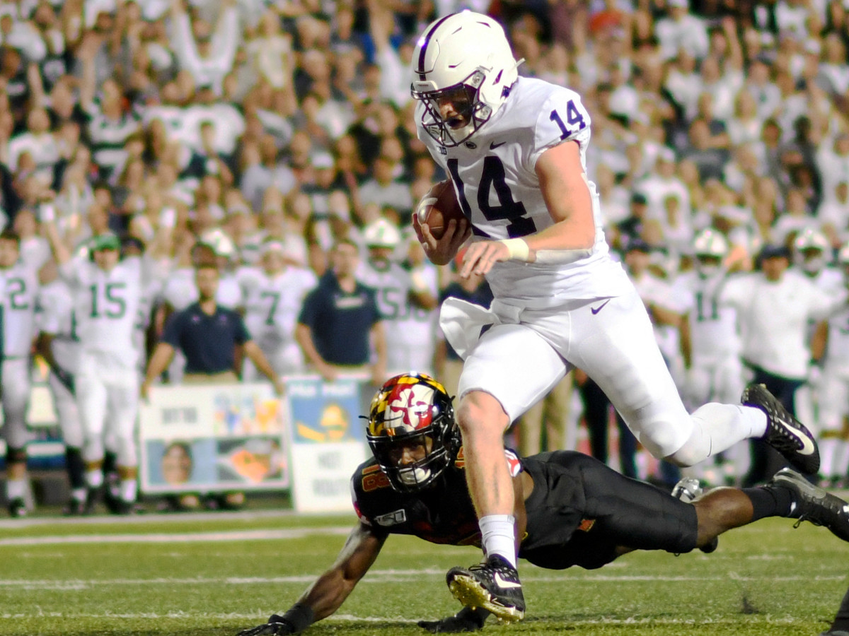 Penn State quarterback Sean Clifford (14) rushes for a touchdown in the first quarter of the Nittany Lions' 59-0 win over Maryland on Friday, Sept. 27, 2019, at Capital One Field at Maryland Stadium in College Park, Md. (Mark Goldman/Icon Sportswire via Getty Images)