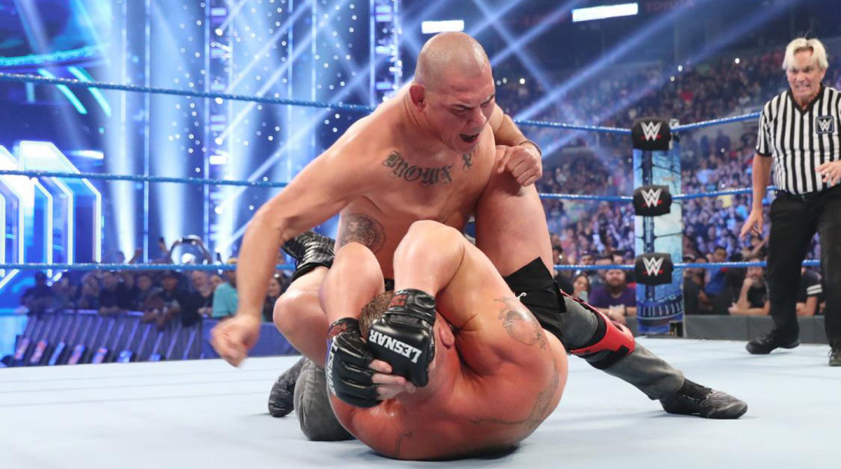 Brock Lesnar was attacked by Cain Velasquez following his win over Kofi Kingston.