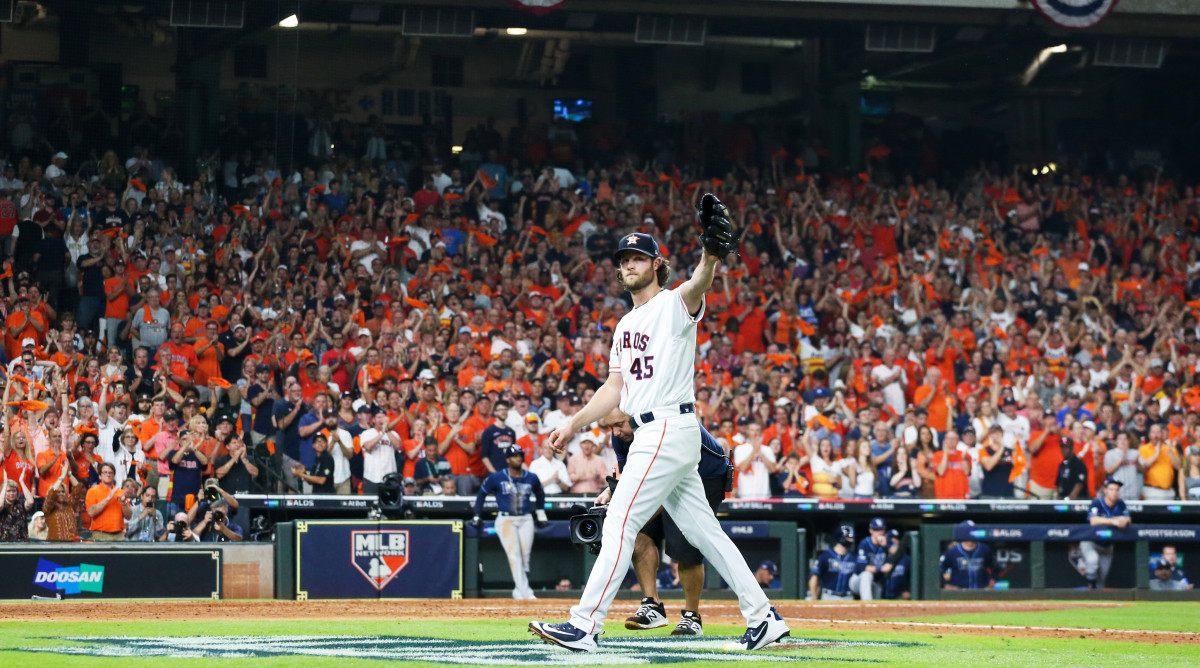 Oct 5, 2019; Houston, TX, USA; Houston Astros starting pitcher Gerrit Cole (45) reacts to the fans as he leaves the game against the Tampa Bay Rays in the eighth inning in game two of the 2019 ALDS playoff baseball series at Minute Maid Park. Mandatory Credit: Thomas B. Shea-USA TODAY Sports