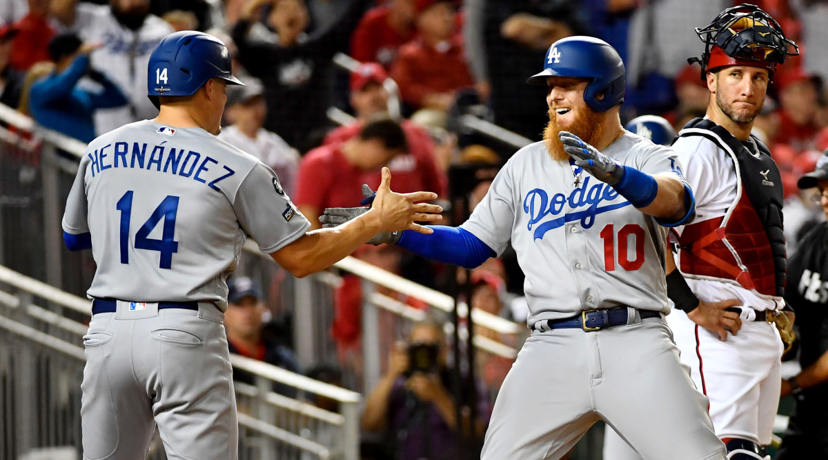October 6, 2019; Washington, DC, USA; Los Angeles Dodgers third baseman Justin Turner (10) is congratulated by player Enrique Hernandez (14) for both scoring on a three-run home run by Turner in the sixth inning against the Washington Nationals in game three of the 2019 NLDS playoff baseball series at Nationals Park. Mandatory Credit: Brad Mills-USA TODAY Sports