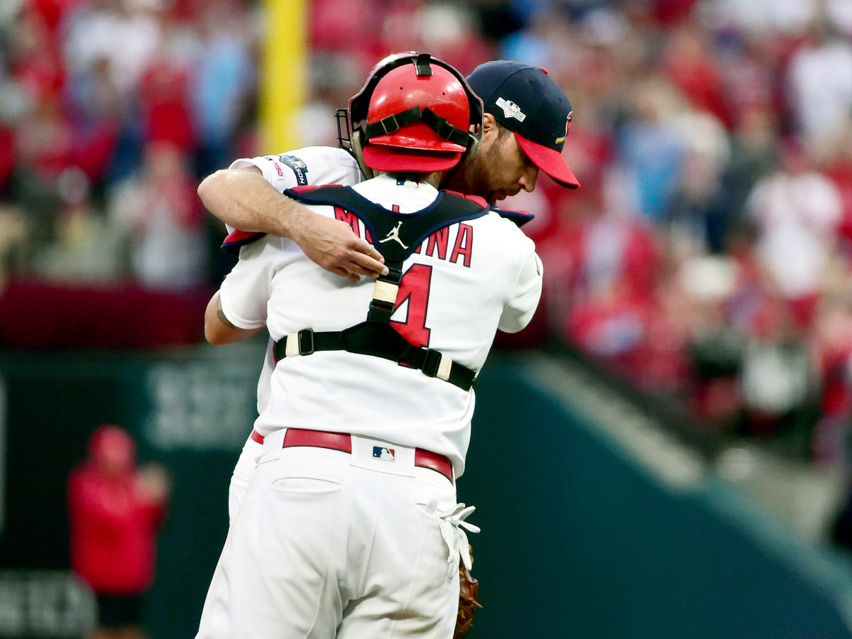 Oct 6, 2019; St. Louis, MO, USA; St. Louis Cardinals pitcher Adam Wainwright (50) hugs catcher Yadier Molina (4) after he Wainwright is relieved in the eighth inning in game three of the 2019 NLDS playoff baseball series against the Atlanta Braves at Busch Stadium. Mandatory Credit: Jeff Curry-USA TODAY Sports
