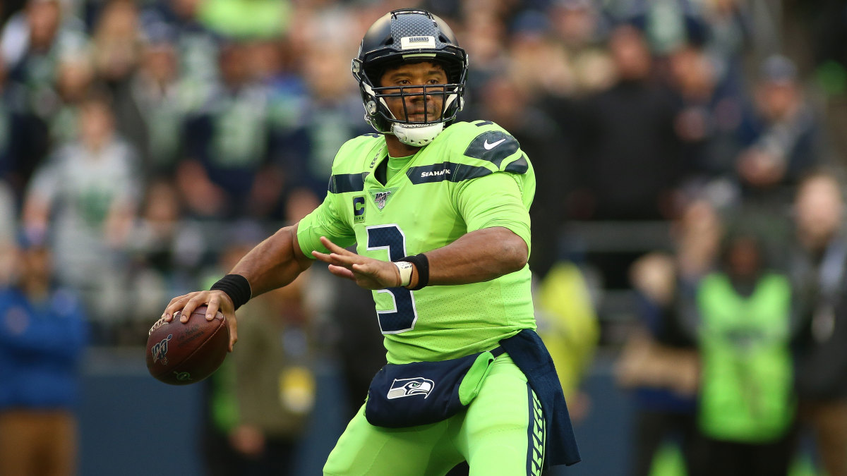 Russell-Wilson-Throws-Football-Seahawks
