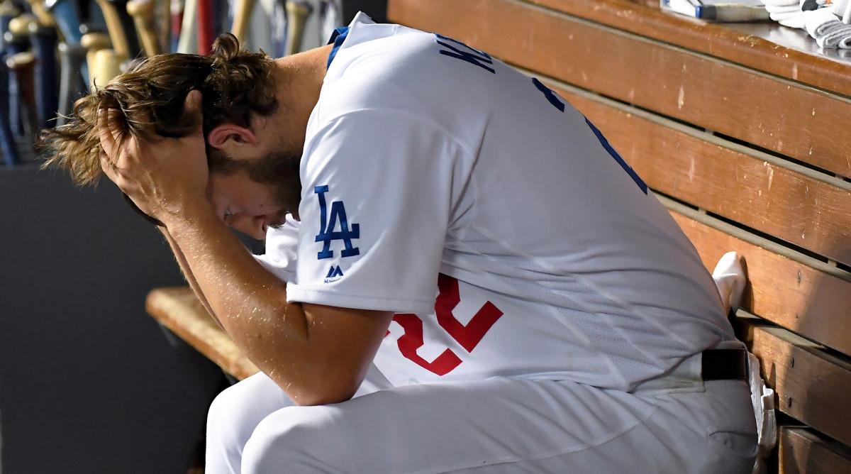 Oct 9, 2019; Los Angeles, CA, USA; Los Angeles Dodgers starting pitcher Clayton Kershaw (22) reacts in the dugout during the eighth inning in game five of the 2019 NLDS playoff baseball series against the Washington Nationals at Dodger Stadium. Mandatory Credit: Jayne Kamin-Oncea-USA TODAY Sports