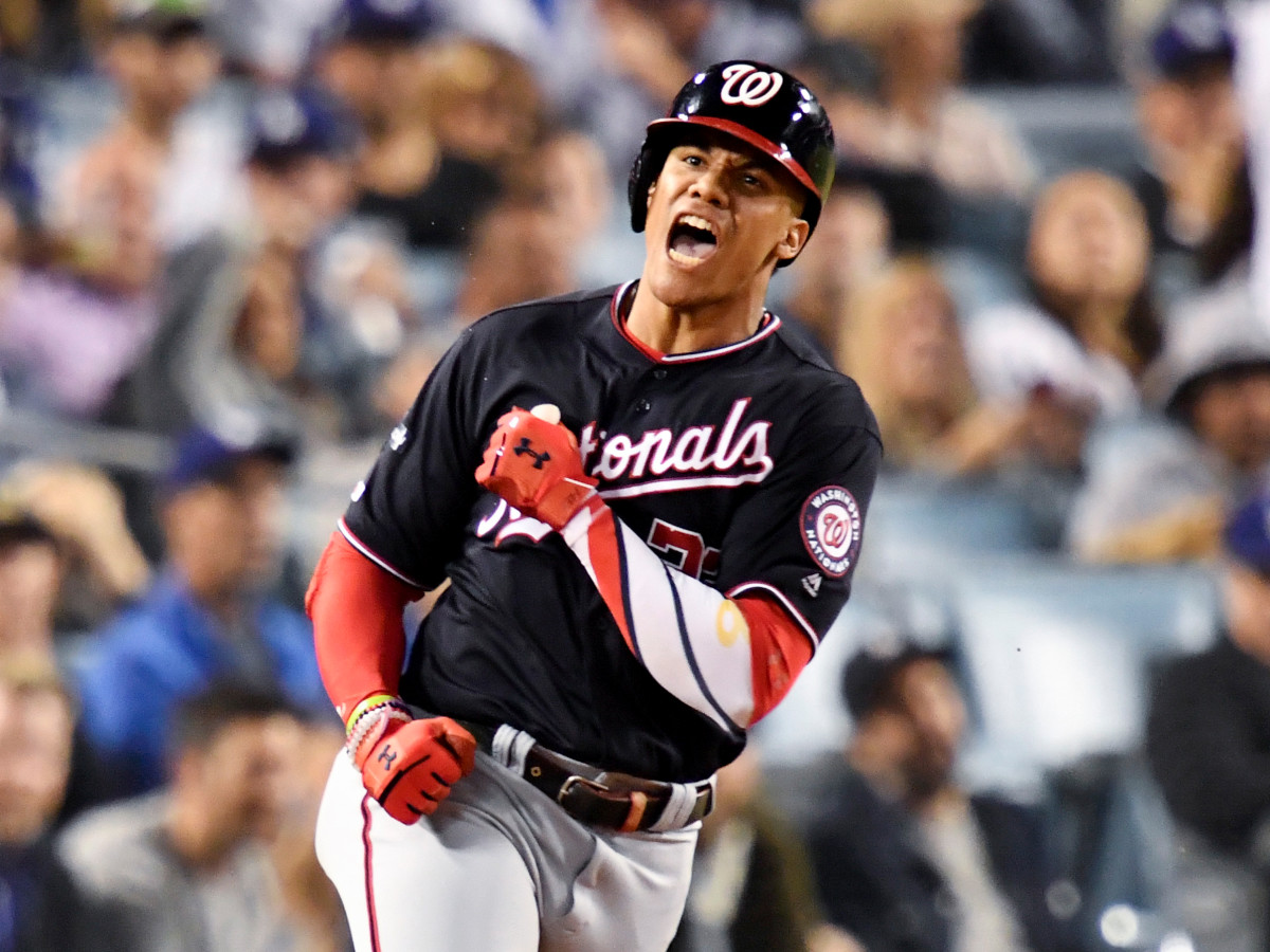 Oct 9, 2019; Los Angeles, CA, USA; Washington Nationals left fielder Juan Soto (22) celebrates after a solo home run during the eighth inning in game five of the 2019 NLDS playoff baseball series against the Los Angeles Dodgers at Dodger Stadium. Mandatory Credit: Robert Hanashiro-USA TODAY Sports