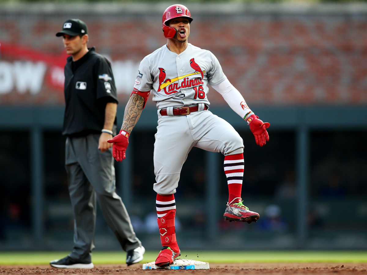 Oct 9, 2019; Atlanta, GA, USA; St. Louis Cardinals second baseman Kolten Wong (16) celebrates at second base after driving  in two runs with a double against the Atlanta Braves in the first inning of game five of the 2019 NLDS playoff baseball series at SunTrust Park. Mandatory Credit: Brett Davis-USA TODAY Sports