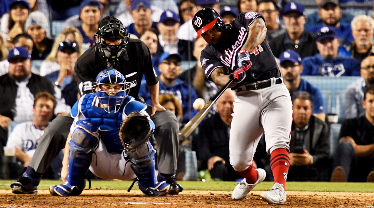 Oct 9, 2019; Los Angeles, CA, USA; Washington Nationals second baseman Howie Kendrick (47) hits a grand slam during the 10th inning in game five of the 2019 NLDS playoff baseball series against the Los Angeles Dodgers at Dodger Stadium. Mandatory Credit: Robert Hanashiro-USA TODAY Sports