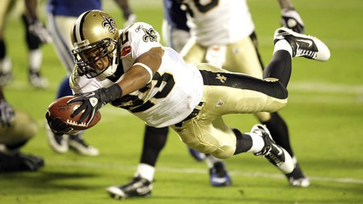 Feb 7, 2010 ; Miami Gardens, FL, USA; New Orleans Saints running back Pierre Thomas (23) dives across the goal line for a touchdown in the third quarter of Super Bowl XLIV at Sun-Life Stadium. The Saints defeated the Indianapolis Colts 31-17. Mandatory Credit: Matthew Emmons – US PRESSWIRE