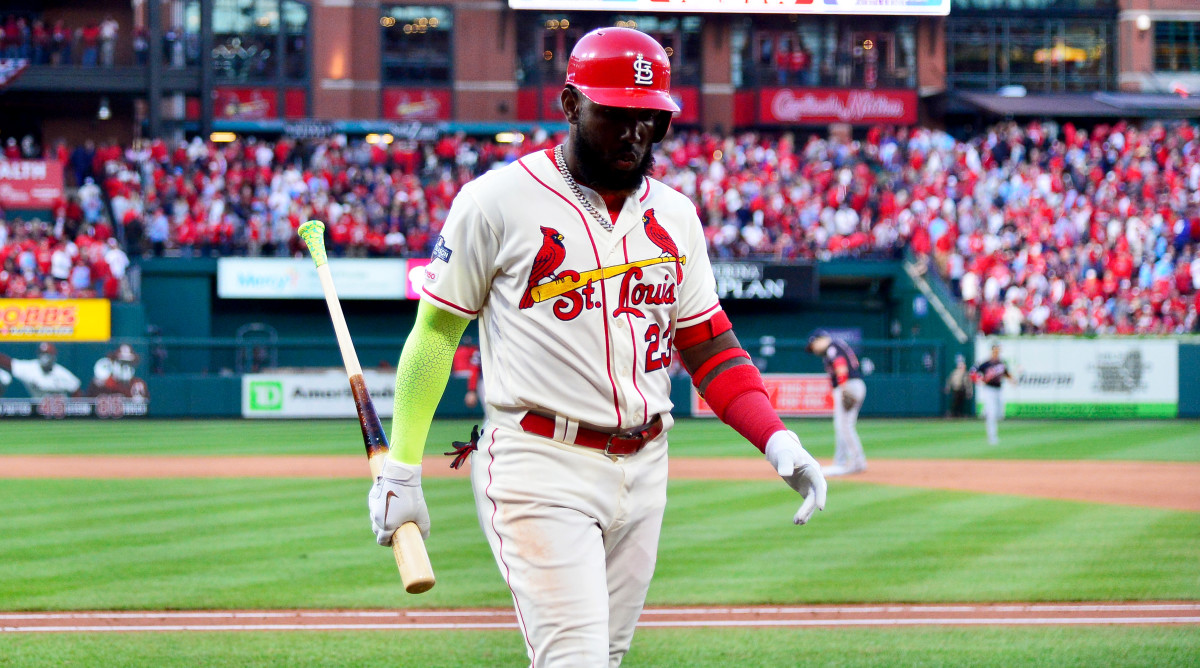Oct 12, 2019; St. Louis, MO, USA; St. Louis Cardinals left fielder Marcell Ozuna (23) walks back to the dugout after making the final out of the game against the Washington Nationals in game two of the 2019 NLCS playoff baseball series at Busch Stadium. Mandatory Credit: Jeff Curry-USA TODAY Sports