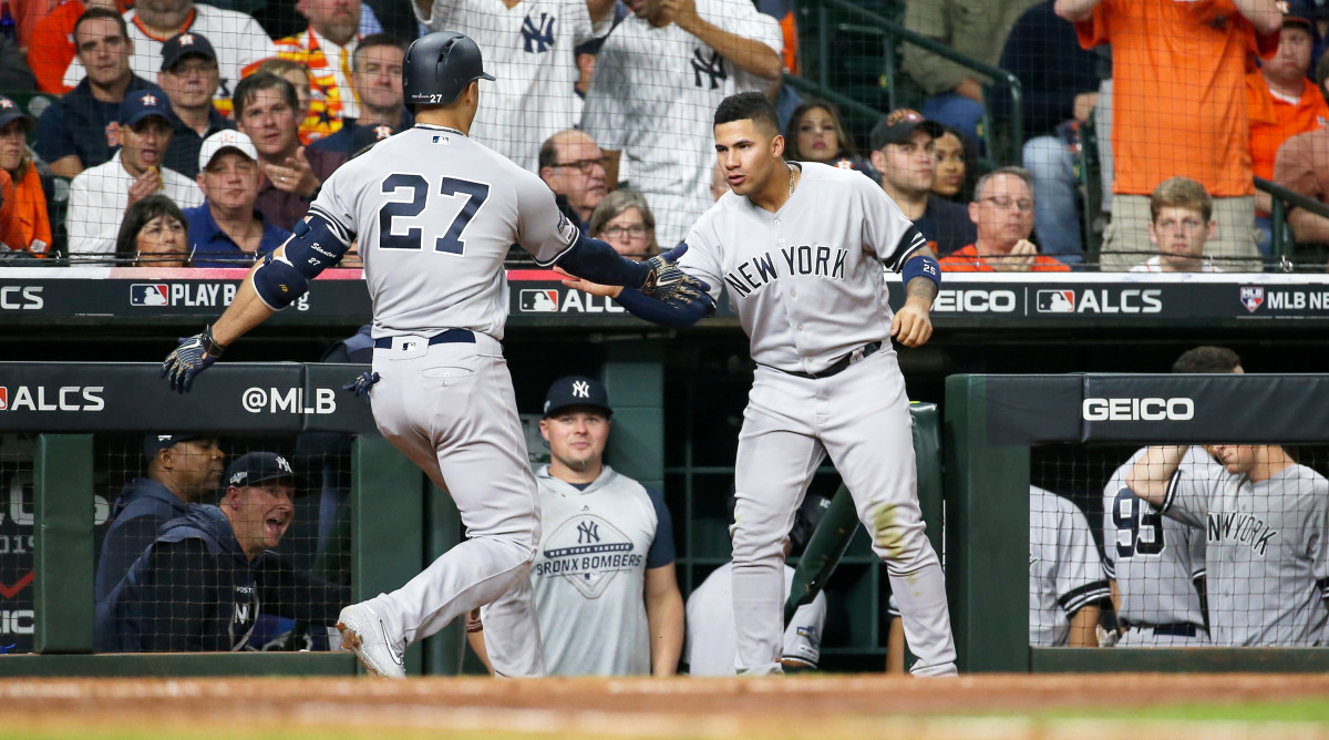 Oct 12, 2019; Houston, TX, USA; New York Yankees left fielder Giancarlo Stanton (27) celebrates with second baseman Gleyber Torres (25) after hitting a solo home run against the Houston Astros in the sixth inning in game one of the 2019 ALCS playoff baseball series at Minute Maid Park. Mandatory Credit: Troy Taormina-USA TODAY Sports