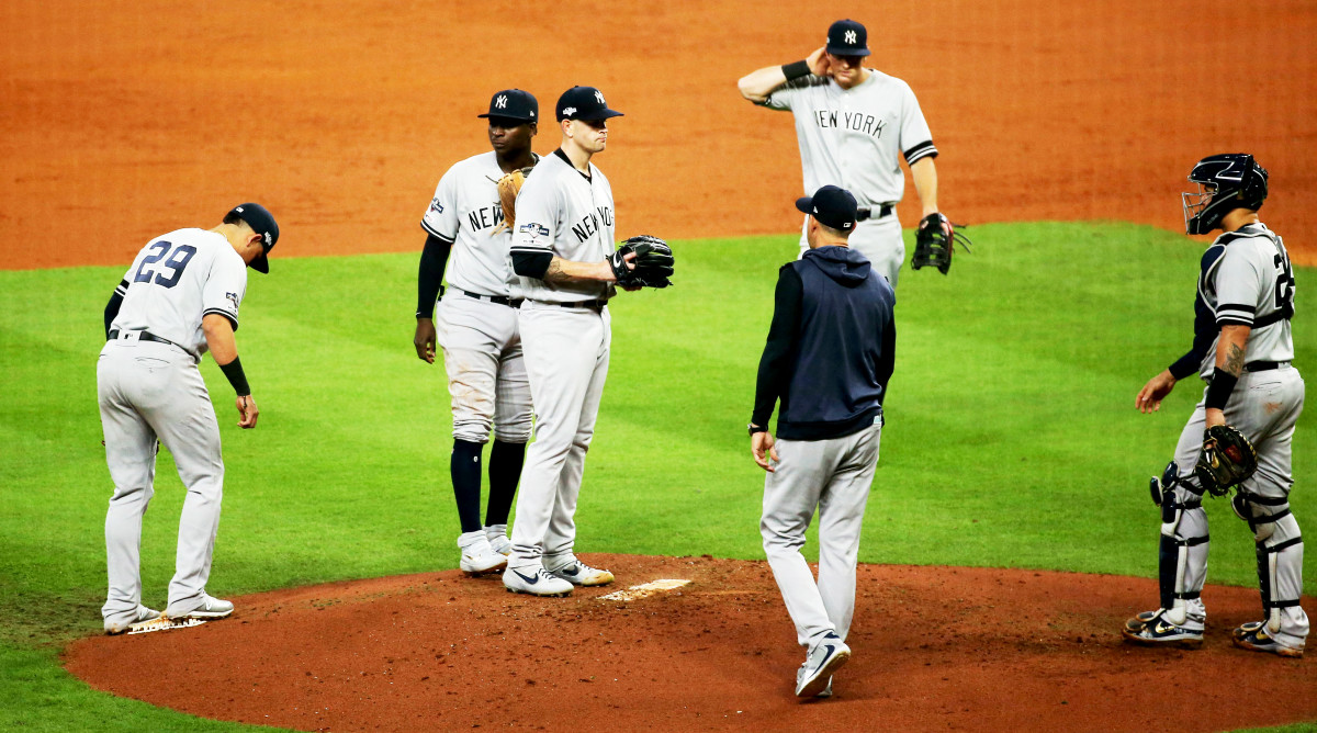 Oct 13, 2019; Houston, TX, USA; New York Yankees starting pitcher James Paxton (65) is removed from the game by manager Aaron Boone (17) during the third inning in game two of the 2019 ALCS playoff baseball series against the Houston Astros at Minute Maid Park. Mandatory Credit: Troy Taormina-USA TODAY Sports