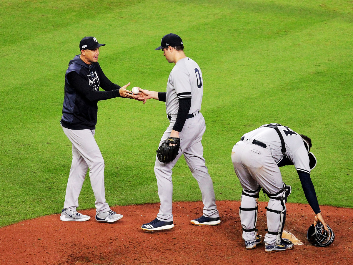 Oct 13, 2019; Houston, TX, USA; New York Yankees manager Aaron Boone (17) removes relief pitcher Adam Ottavino (0) during the fifth inning in game two of the 2019 ALCS playoff baseball series against the Houston Astros at Minute Maid Park. Mandatory Credit: Erik Williams-USA TODAY Sports