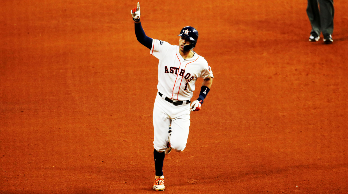 Oct 13, 2019; Houston, TX, USA; Houston Astros shortstop Carlos Correa (1) hits the game-winning solo home run in the 11th inning in game two of the 2019 ALCS playoff baseball series against the New York Yankees at Minute Maid Park. Mandatory Credit: Troy Taormina-USA TODAY Sports