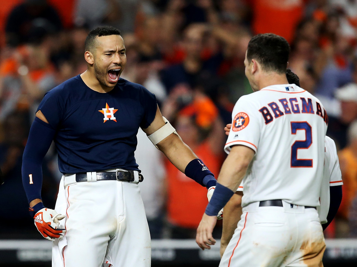 Oct 13, 2019; Houston, TX, USA; Houston Astros shortstop Carlos Correa (1) celebrates with third baseman Alex Bregman (2) after hitting a walk off solo home run off of New York Yankees starting pitcher J.A. Happ (not pictured) during the eleventh inning in game two of the 2019 ALCS playoff baseball series at Minute Maid Park. Mandatory Credit: Thomas B. Shea-USA TODAY Sports