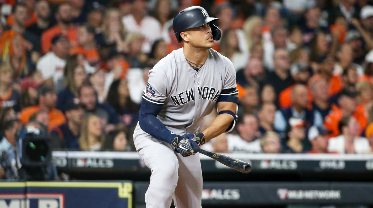 Oct 12, 2019; Houston, TX, USA; New York Yankees left fielder Giancarlo Stanton (27) hits a solo home run against the Houston Astros in the sixth inning in game one of the 2019 ALCS playoff baseball series at Minute Maid Park. Mandatory Credit: Troy Taormina-USA TODAY Sports