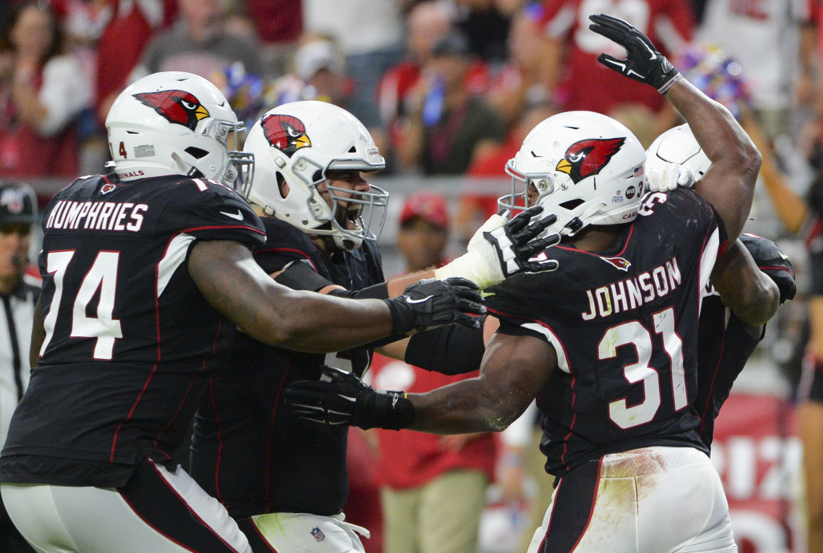 Left tackle DJ Humphries and runningback David Johnson celebrate a big play.