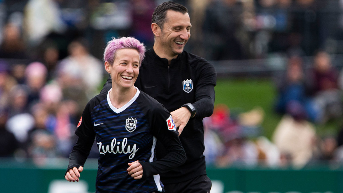 Vlatko Andonovski and Megan Rapinoe of Reign FC