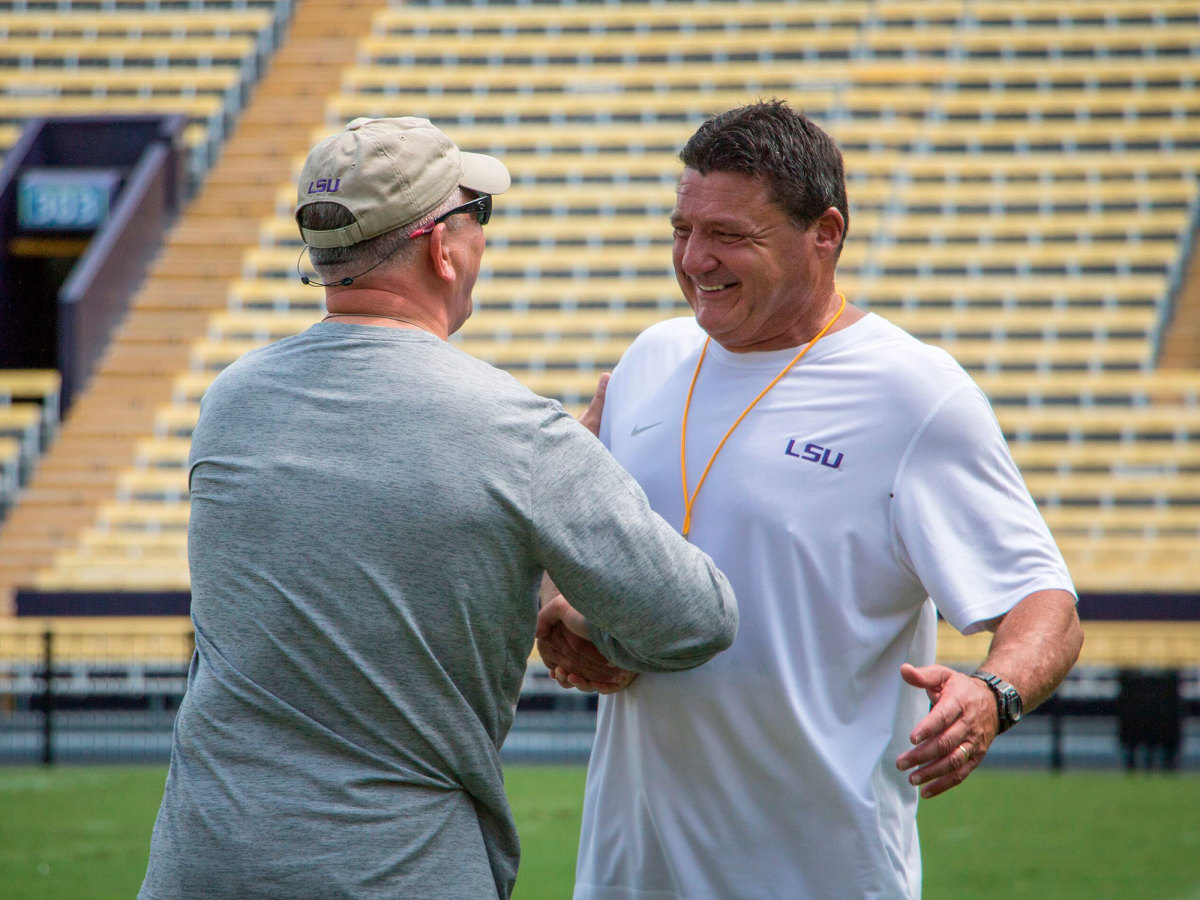 Lousiana Gov. John Bel Edwards and Ed Orgeron during an LSU spring practice