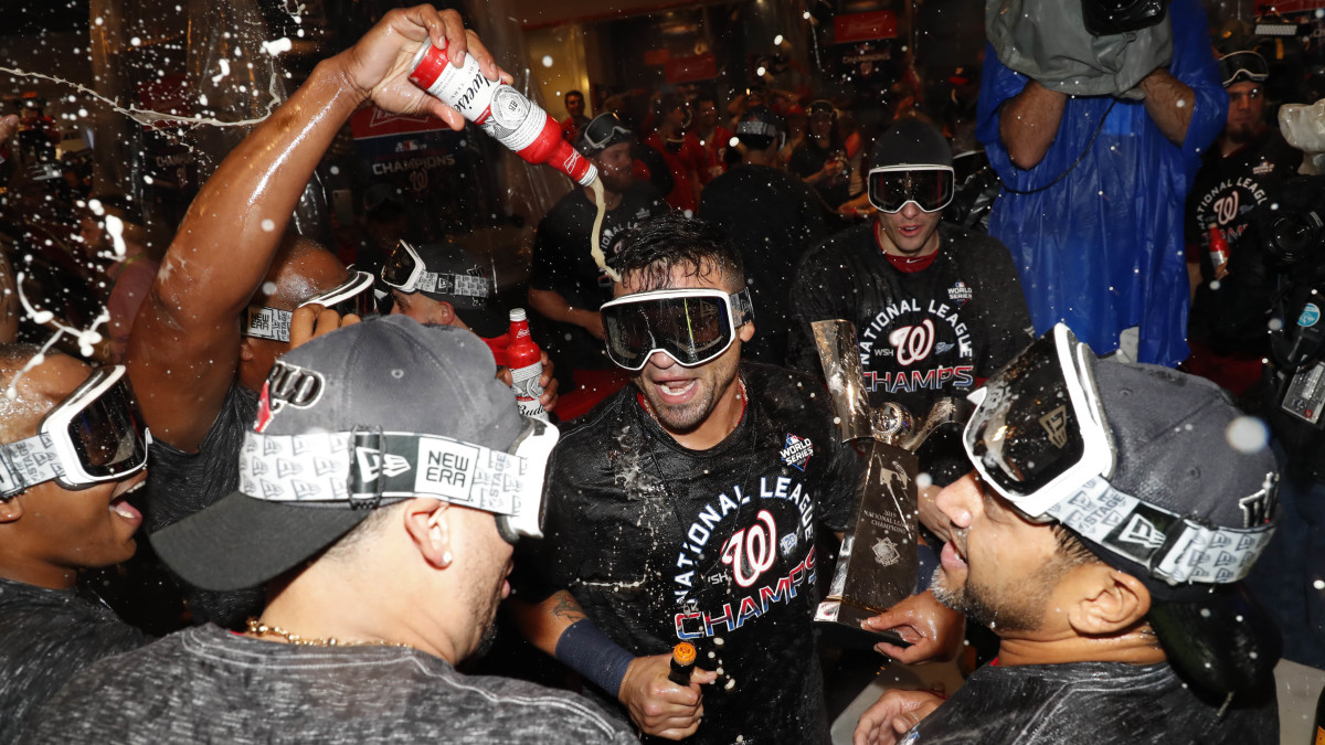 Washington Nationals players celebrate in the clubhouse after winning the National League pennant