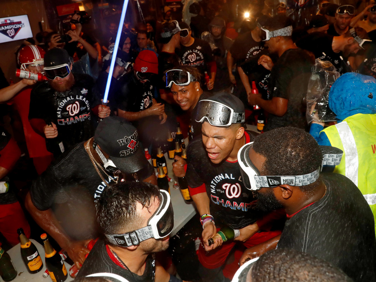 Oct 15, 2019; Washington, DC, USA; Washington Nationals celebrate in the locker room after defeating the St. Louis Cardinals in game four of the 2019 NLCS playoff baseball series at Nationals Park. Mandatory Credit: Geoff Burke-USA TODAY Sports
