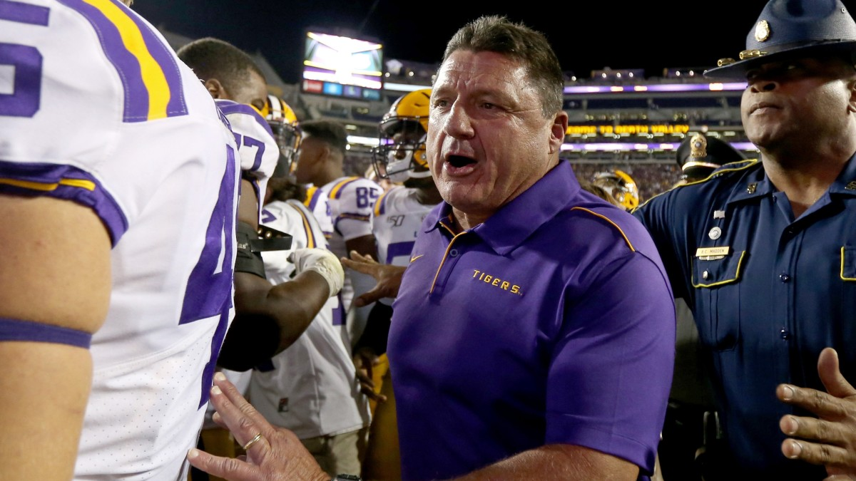 coach orgeron comes off the field after the lsu vs florida game